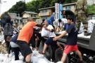 Van 179 muertos por inundaciones en Japón