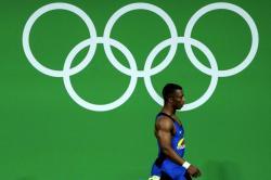 Imágenes de cómo se logra una medalla de oro en pesas por parte de Óscar Figueroa